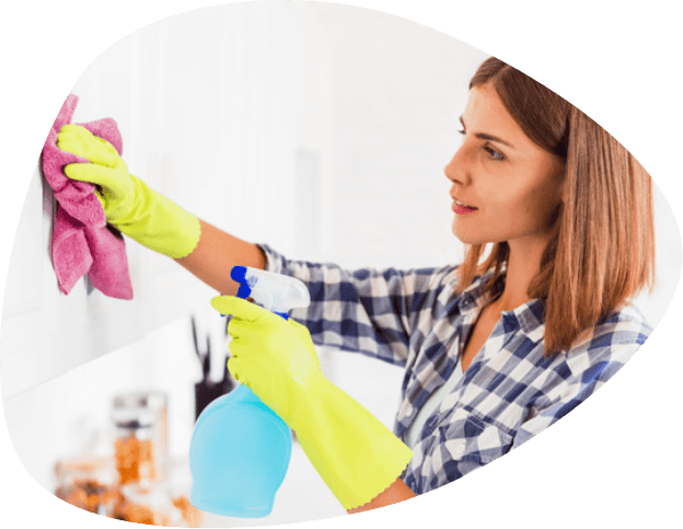 woman while cleaning kitchen