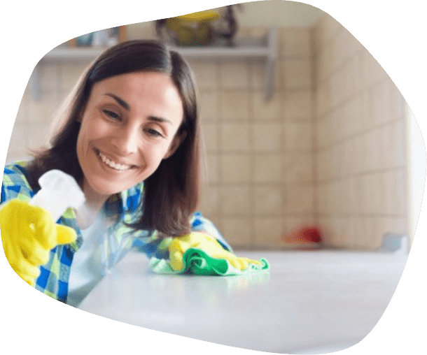 woman while cleaning